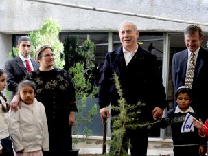 Israeli Prime Minister Benjamin Netanyahu plants a tree on the Jewish holiday of Tu Bishvat.