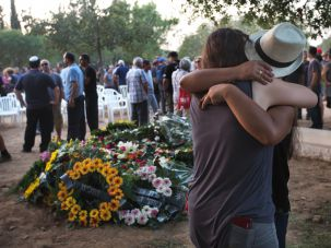 Bereft: Mourners at the grave of Shachar Melamed, one of two kibbutzniks killed August 26, 2014.