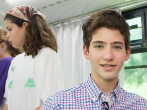 Noah Helfstein, 13,  next to a mobile technology lab in Israel that he funded with his Bar Mitzvah money.