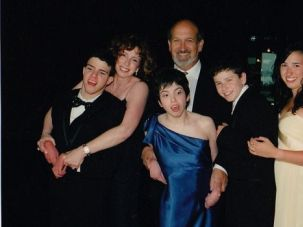 Family History: Randy Yudenfriend-Glaser, the chair of the Jewish Genetic Disease Consortium (second from left), and her husband, Jordan, in a family portrait, hold children Jonathan and Lauren who have ML4, a genetic metabolic disease.