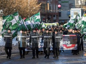 The neo-Nazi Nordic Resistance Movement demonstrates against migrants in central Stockholm.