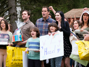 On 'Odd Mom Out,' parents arrive at camp bearing culinary gifts. Andy Buckley (as Andy) is at center in blue plaid shirt, with Jill Kargman (at his left) as Jill.
