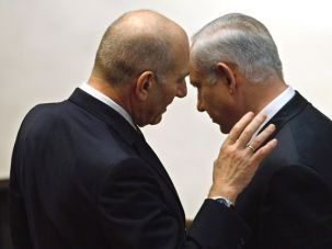 Next: Before his government was sworn in, Benjamin Netanyahu (right) spoke to Ehud Olmert, his predecessor as prime minister.