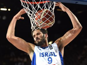 Omri Casspi of the Israeli national basketball team dunks during a game in FIBA's 2015 EuroBasket tournament.