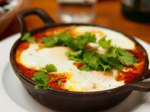Shakshuka, the classic baked egg dish, a là Solomonov.