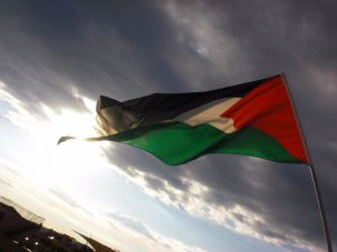 A Palestinian flag waves in the breeze.