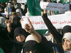 Calling for Freedom: Palestinian women protest the imprisonment of Hamas and Islamic Jihad members in Palestinian Authority prisons in December.