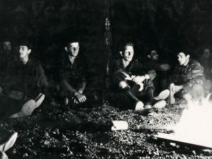 Calm before the storm: soldiers relax by a campfire while training for the Six Day War.