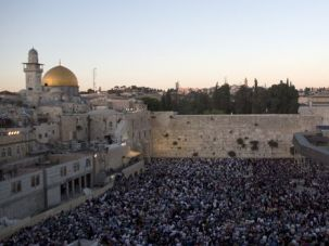 Beseeching: Thousands of Jews gather for a mass prayer at the Kotel.