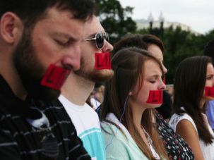 Life Decision: Pro-life protesters stand with red tape over their mouths in front of the U.S. Supreme Court in anticipation of the Hobby Lobby decision.