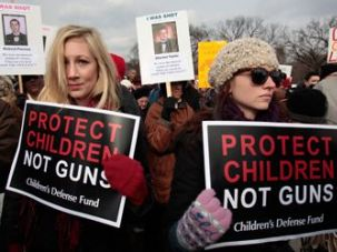 Protestors demonstrate at the March on Washington for Gun Control on January 26, 2013.