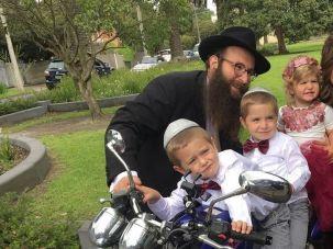 Rabbi Chaim and Rochel Telsner and children.