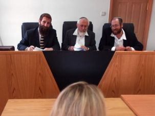 Faithful Moment: A woman faces questions from a rabbinic panel in Jerusalem as part of her conversion process.
