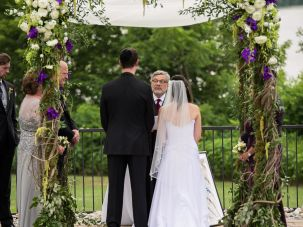 Rabbi Seymour Rosenbloom officiates an intermarriage.