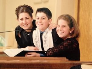 Caroline Rothstein, left, with her brother, Josh, at his Bar Mitzvah.