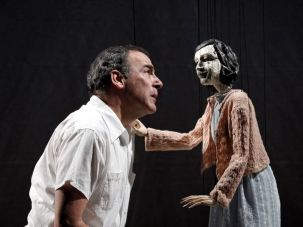 Pulling His Strings: Sid Silver (Mandy Patinkin) in earnest discussion with a marionette Anne Frank.