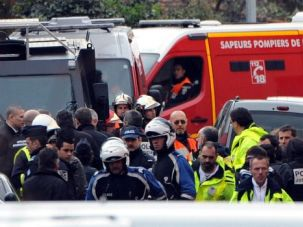 Aftermath: French police guard the street where suspected school shooter Mohammed Merah plunged to his death.