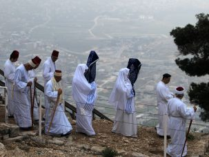Samaritans walk up Mount Gerizim, near the northern West Bank city of Nablus, for a Passover ceremony early on April 27, 2016.