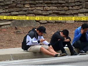 Waiting: Students at Santa Monica College wait outside of Friday?s crime scene where six students were shot and killed.