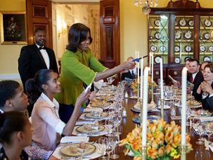 Welcoming Elijah: First Lady Michelle Obama lit candles to begin a White House Seder.