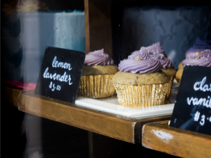 Lemon-lavender and classic vanilla cupcakes in the window of Sweet Generation.