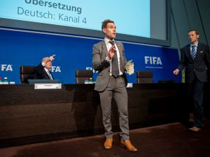 Comedian Simon Brodkin prepares to attack FIFA President Joseph S. Blatter (L) with money during a press conference at the Extraordinary FIFA Executive Committee Meeting at the FIFA headquarters on July 20, 2015 in Zurich, Switzerland. [[Your text to link here…