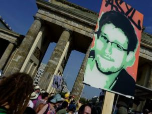 Surveillance:  Protestors in Germany demonstrate in support of Snowden.