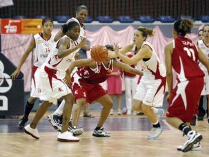 Winners: Electra Ramat Hasharon, a champion women?s basketball team (in white), controls the ball on court during a recent game.