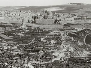 Once Empty: The City of David, located on a ridge extending south from the Temple Mount, was once mostly empty of buildings. Here the archaeological site is seen in the foreground in front of the Temple Mount sometime during the first half of the 20th century. Across the Kidron Valley, at right, is the Arab village of Silwan, which has since expanded into the City of David site.