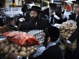 The Face of Poverty: Ultra-Orthodox Jews in Jerusalem carry donated food for the poor from a food distribution center before the Passover holiday, April 13, 2011. About 60% of Israel?s ultra-Orthodox Jews, or Haredim, live in poverty.