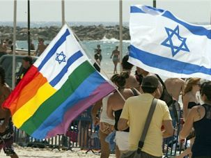 Gay Oasis: Israelis carry flags during last year?s gay pride parade in Tel Aviv.