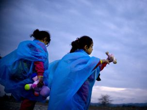 On the Move: Migrant girls play with toys at a camp near Gevgelija, Macedonia, after crossing the border from Greece.