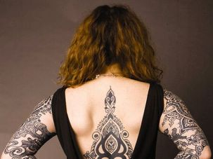 Her two sleeves and backpiece are by blackwork specialist Daniel DiMattia (her former husband and lifelong friend). (Photo by David Kimelberg)