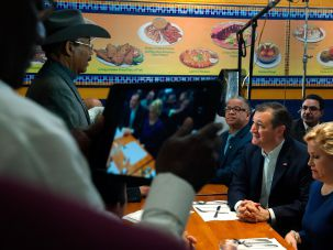 Presidential candidate Ted Cruz speaks with New York State Senator Ruben Diaz at a Bronx restaurant during Cruz' campaign visit on April 6.
