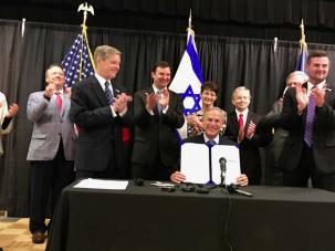 Texas Gov. Greg Abbott signs an anti-BDS law at the Austin Jewish Community Center.