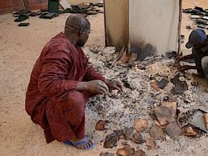Rescue: Men recover ancient manuscripts in January after the French seized Timbuktu from Islamic rebels.