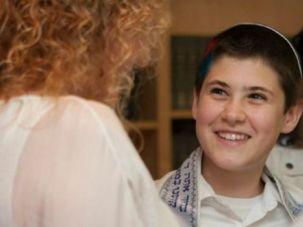 Luckiest Boy in the World: Rabbi Tsipi Gabai leads a naming ceremony for Tom Sosnik in the Beit Midrash at Tehiyah Day School.