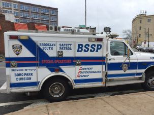 A massive Shomrim vehicle parked on a Boro Park street.