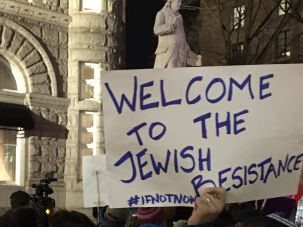 Protestors outside the Trump Hotel in Washington during the Conference of Presidents Hanukkah reception