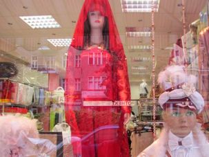 Window Shopping: A Turkish clothing store in Berlin displays its wares, offering veils for women and turbans for young boys, for their circumcision ceremonies.