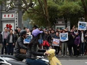Activists chant anti-China slogans during a rally in Hanoi on March 14, 2016, to mark the anniversary of a 1988 battle in the Spratly Islands, a rare act of protest over an issue that has come to dog relations between Hanoi and Beijing. In 1988 China launched an attack on Gac Ma Island — one of the larger Spratly Islands which was formerly under Vietnamese military control — killing 64 Vietnamese soldiers in the last violent conflict between the two nations. / AFP / HOANG DINH NAM (Photo credit should read HOANG DINH NAM/AFP/Getty Images)