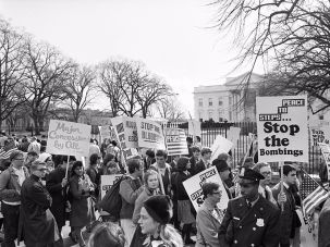 Protesters demonstrate against the Vietnam War just months after the bloody battle that the Pentagon marks as the beginning of the conflict.