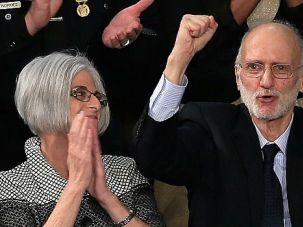 Home Sweet Home: Alan Gross, shown here basking in applause at the State of the Union address, enjoyed a welcome home party at his synagogue in Rockville, Md.