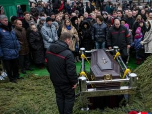 Mourning a Movement: People gather around the coffin of opposition leader Boris Nemtsov at a Moscow cemetery.