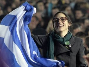 Supporter of the lefitst Syriza party celebrates win in Athens.