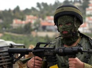 Israeli soldier protects Jewish settlement in the occupied West Bank.