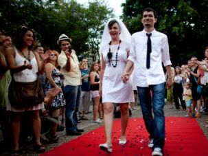 We Do: Israeli bride Yulia Tagil and her groom, Stas Granin, hold an alternative wedding ceremony at a public square in Tel Aviv to protest Orthodox control over marriage.