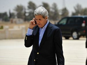 Shuttle Guy: John Kerry talks on phone as he tries to push Israel and the Palestinians to launch peace talks.