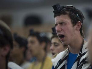 Beseeching: A Jewish student prays for the three teenagers believed to have been kidnapped by militants.