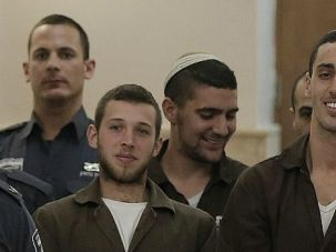 Faces of Hate: Members of Lehava, a Jewish extremist group that opposes coexistence with Arabs, grin during court appearance on charges they firebombed a Jerusalem school.
